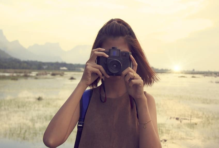 Young woman taking photograph